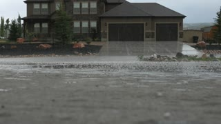Hail falling on a driveway