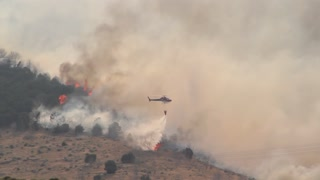 Helicopter fighting big wildfire