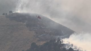 Helicopter fighting huge blaze