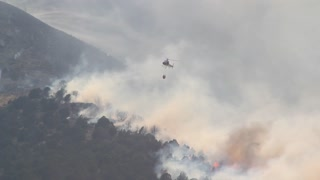 Helicopter trying to put out wild fire