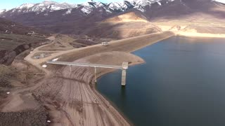 High aerial shot of a mountain reservoir and dam