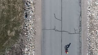 High aerial shot of cute little boy on a bike ride