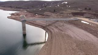 High aerial shot of mountain reservoir and dam
