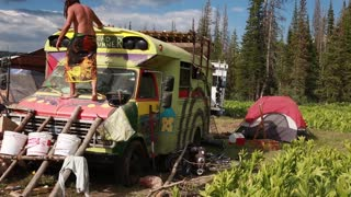 hippie bus at rainbow family gathering at utah