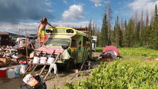 hippie buses at rainbow family gathering at utah
