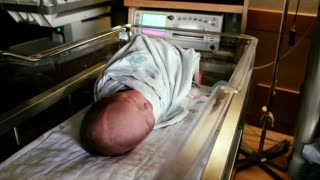 Hospital Crib with Newborn Baby