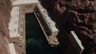 Hover Dam on the Colorado River at lake Mead panning shot