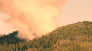 Huge mountain wildfire and smoke