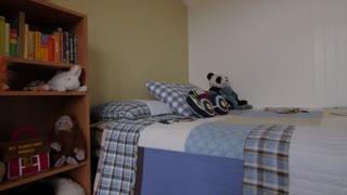 Jib shot of inside boys bedroom