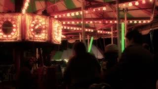 Kids riding carnival carousal