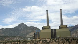 Large coal power plant in Southern Utah panning shot