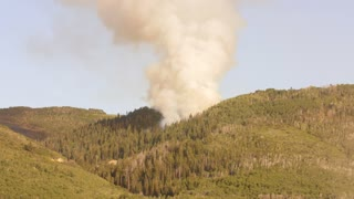 Large mountain wildfire and smoke
