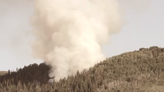 Large mountain wildfire burning