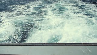 Large wake behind a fishing boat in the ocean cape breton