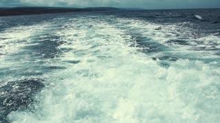 Large wake behind fishing boat in the ocean cape breton