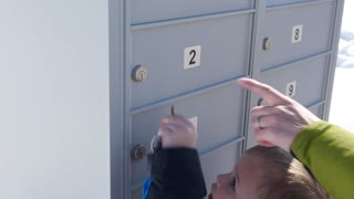Little boy and mother get the mail