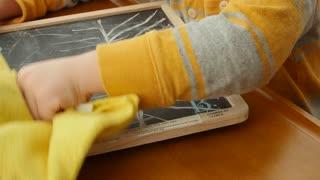 Little boy drawing on his chalkboard