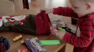 little boy on christmas morning with his stocking