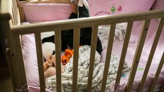 little boy waking up in crib timelapse
