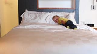 Little boy watching tv in modern hotel room