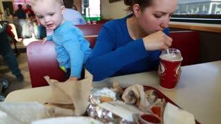 little family eating a milk shake