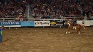 little girl riding horse at rodeo slow motion