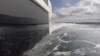 Low shot of a fishing boat cruising through ocean waves