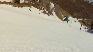low shot of skiing down hill