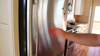 Man looks through fridge