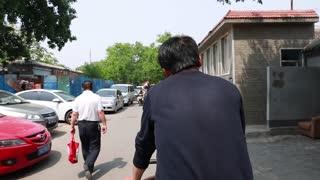 man on bike in beijing china