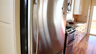 Man puts milk in fridge