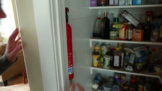 man removes fire extinguisher