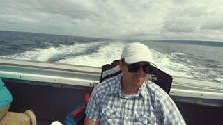 Man riding on fishing boat Cape Breton