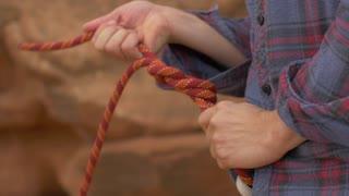 Man rock climbing in Moab in Southern Utah