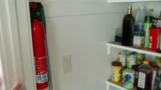 man takes fire extinguisher