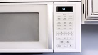 Man turns on microwave