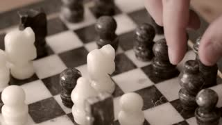 Men playing chess closeup