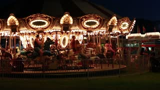merry go round at night time with flashing lights
