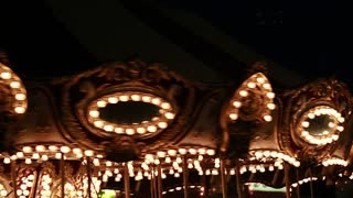 merry go round at night time with lights