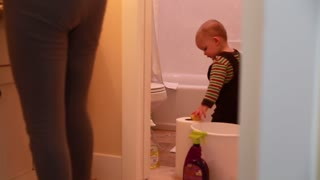 mother and her toddler cleaning a bathroom