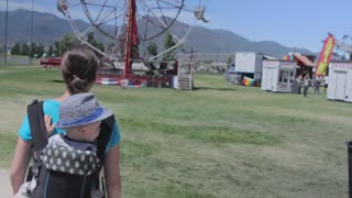 mother and toddler at a carnival fair