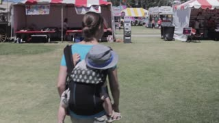 mother and toddler at fair