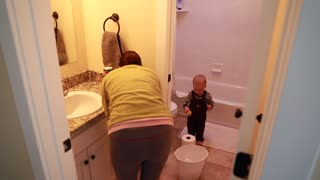 mother and toddler cleaning the bathroom