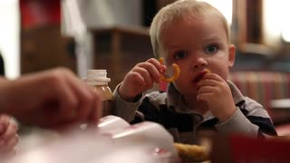 mother and toddler eating fast food