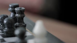 Old chess board closeup dolly shot