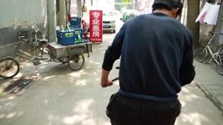 pedaling the rickshaw bike in china