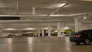 People and cars in parking garage