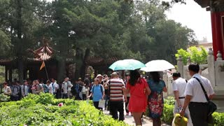 people at the forbidden city garden in beijing china
