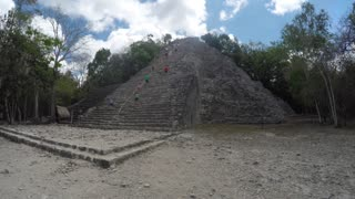 People climb amazing Mayan ruin in Coba near Tulum Mexico