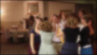 People dance at a wedding reception
